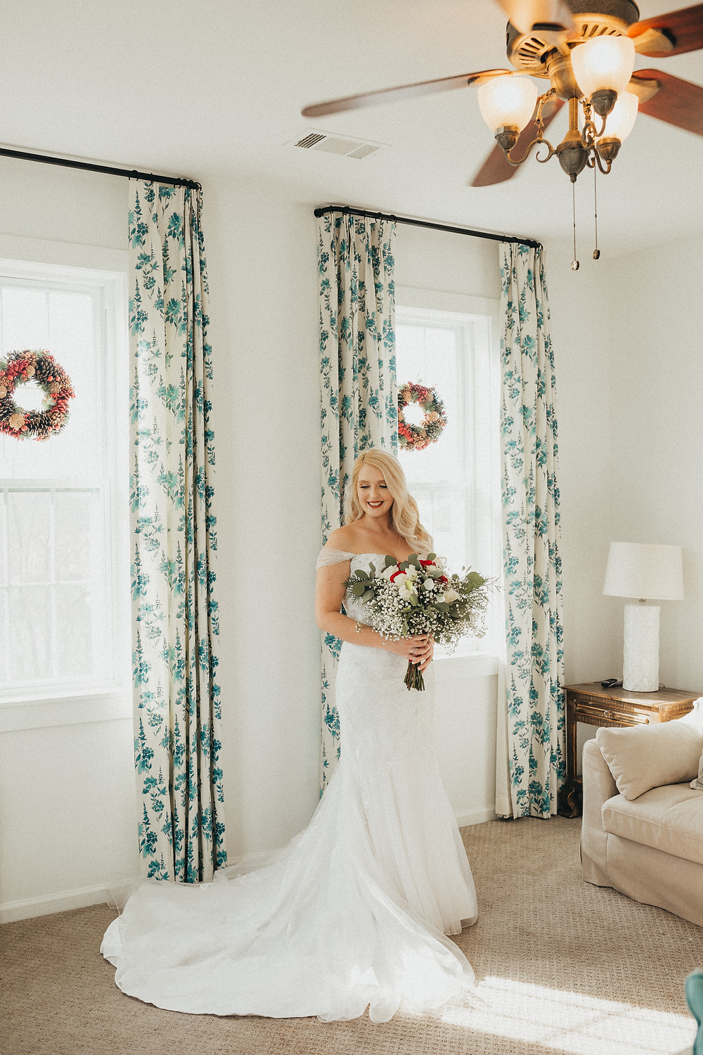 bride smiling down and holding bouquet