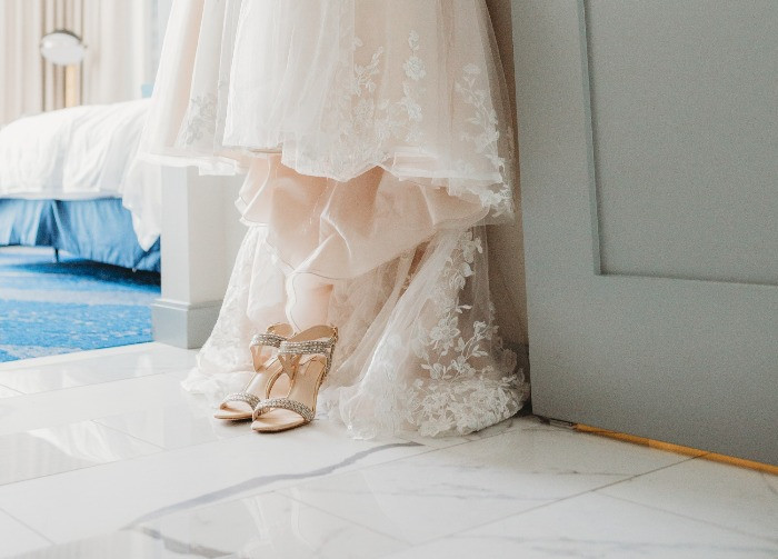 brides shoes and wedding dress
