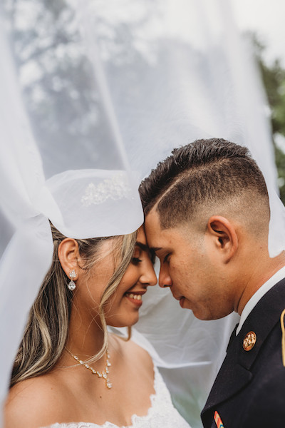 newly married couple under veil in central florida