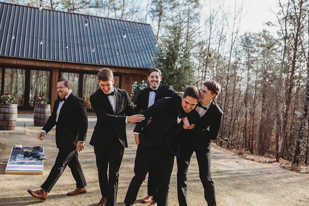 groomsmen having fun before ceremony