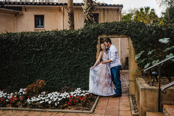 engaged couple holding each other in doorway