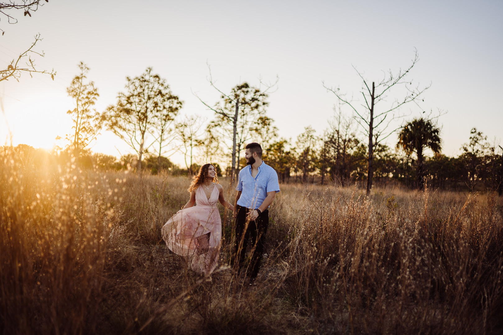 engaged couple in a field