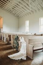wedding-dress-on-a-bench-in-a-church