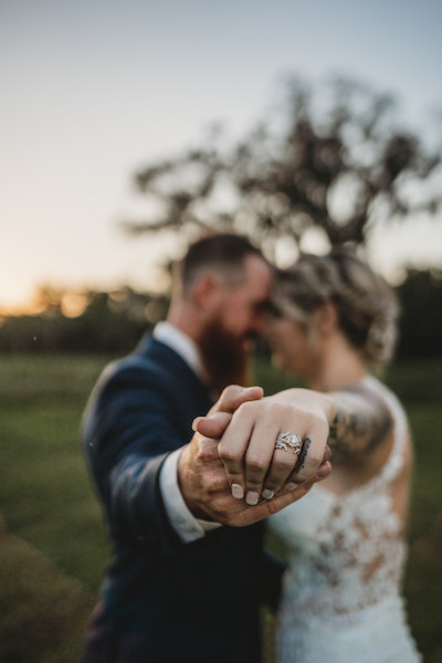 central florida wedding newly weds holding each other showing wedding ring