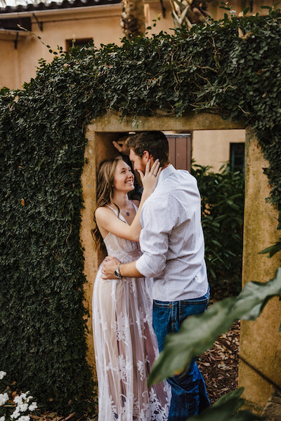 engaged couple in doorway at bok tower gardens in polk county