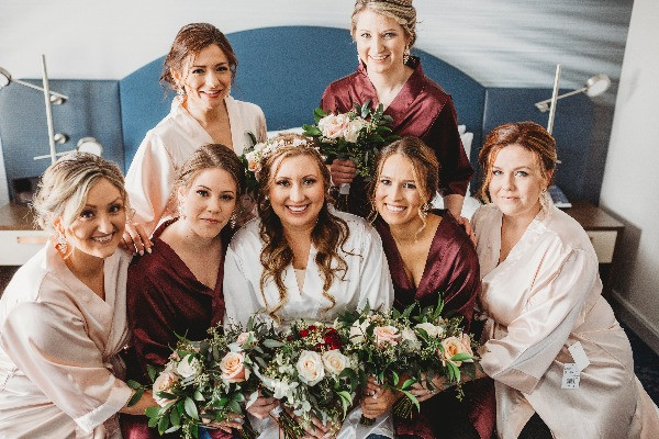 bridesmaids together before wedding ceremony
