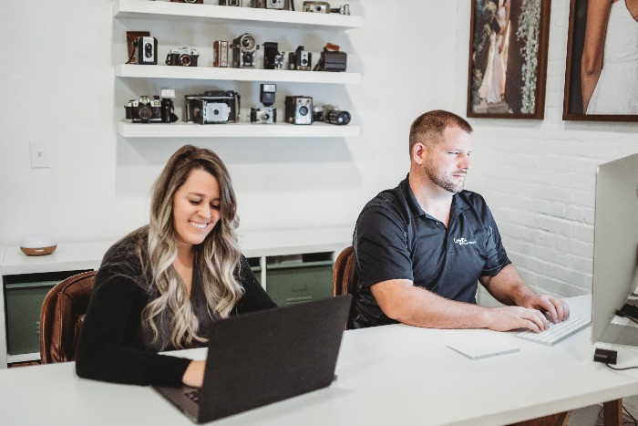 owners of leyre photography working in thier office