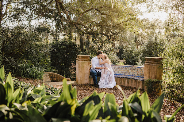 engagement couple on bench at bok tower gardens in lake wales florida