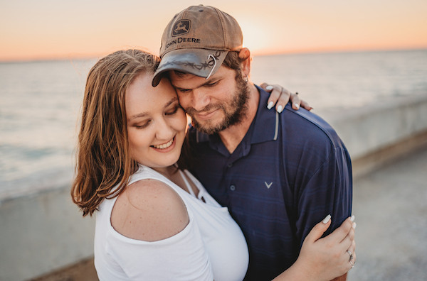 engaged couple holding each other