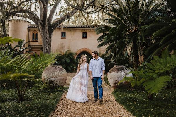 engaged couple walking at bok tower gardens