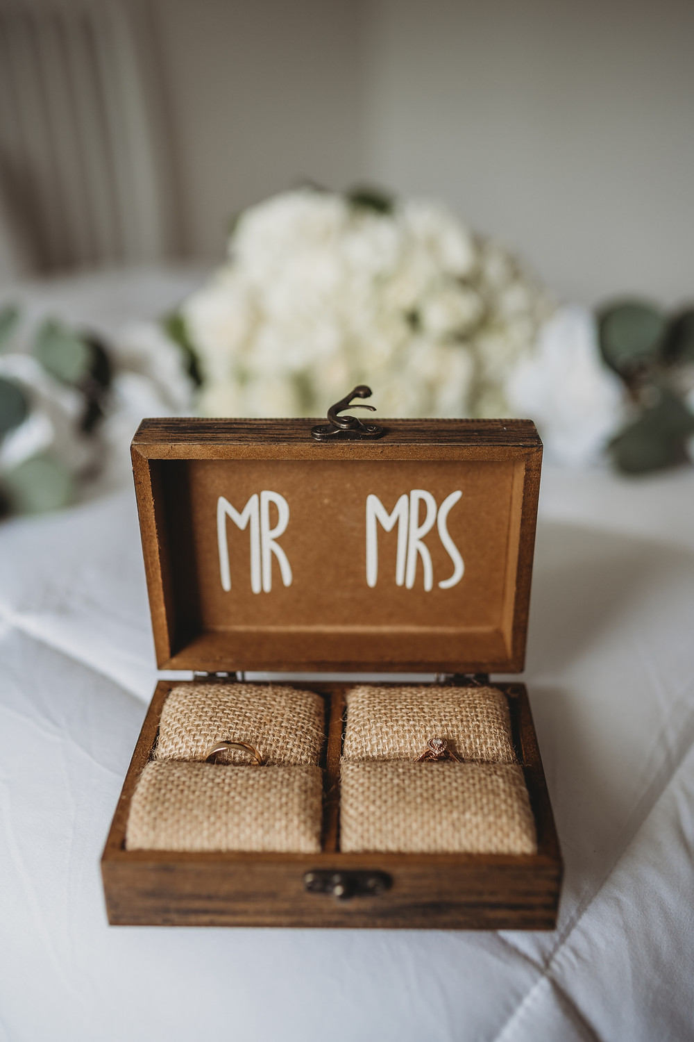 mr and mrs wedding rings in wooden box
