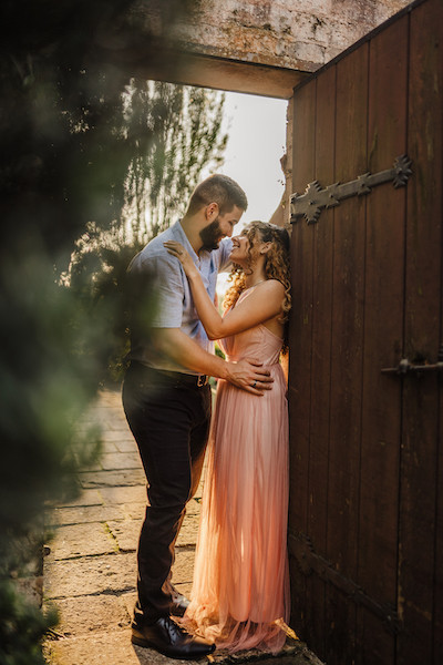 engaged couple in doorway looking at each other