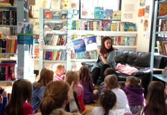 Sharing a picture book at Leaf Cafe, Hertford