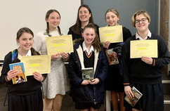 Presenting certificates to winners of the writing competition at Presdales School