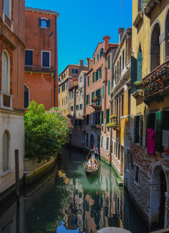 Gondolier on Canal Venice, Italy