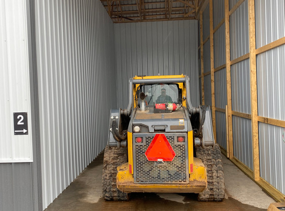 12' x 30' unit. Pictured with a skid steer inside.