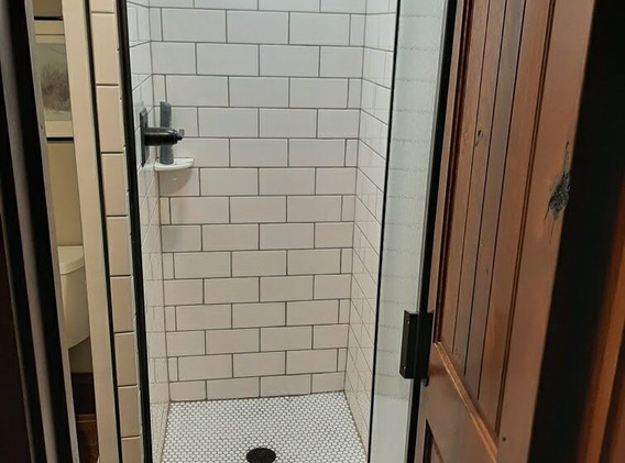 Newly remodeled shower with subway tiles