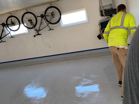 Traffic coating installed in a garage above a living space