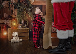Child looking for his name on Santa's li