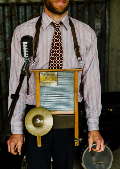 Washboard musician with north east wedding planners