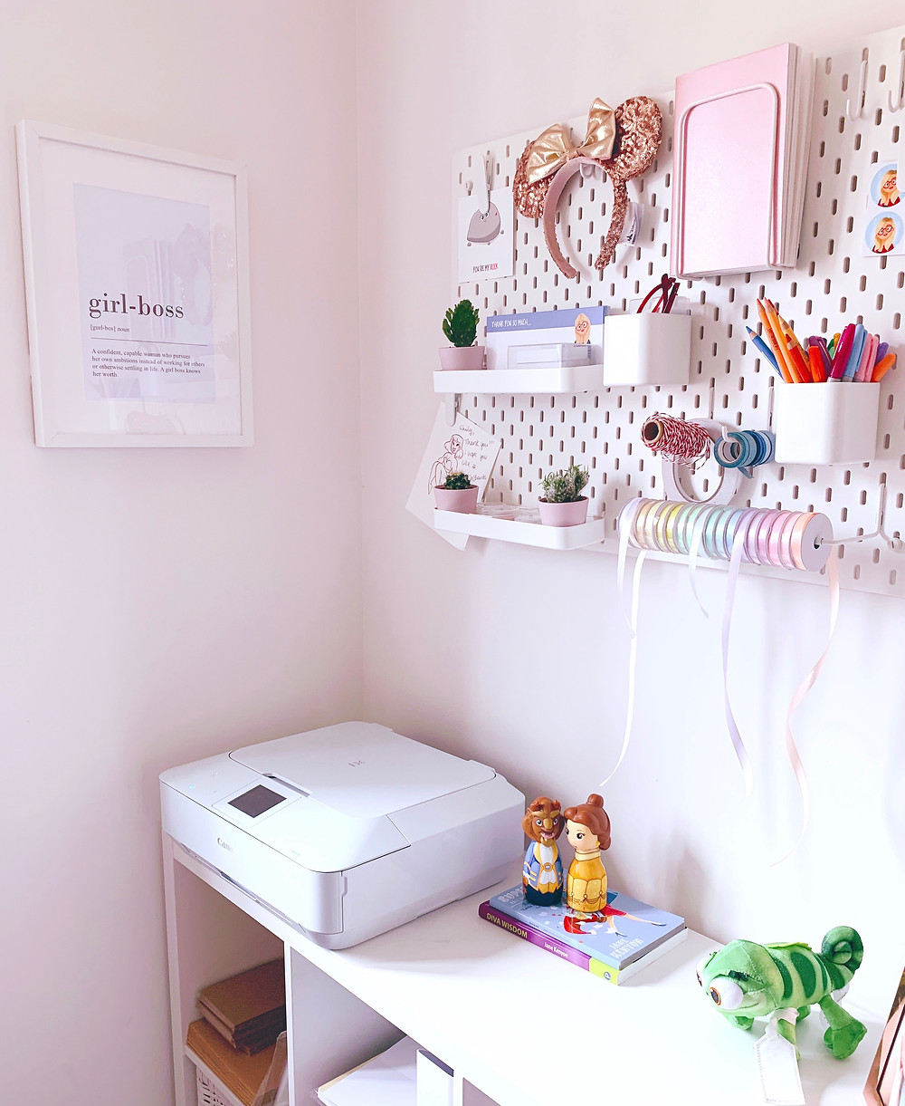 Emily's first studio, her back bedroom of her house. Showing her pegboard and printer.