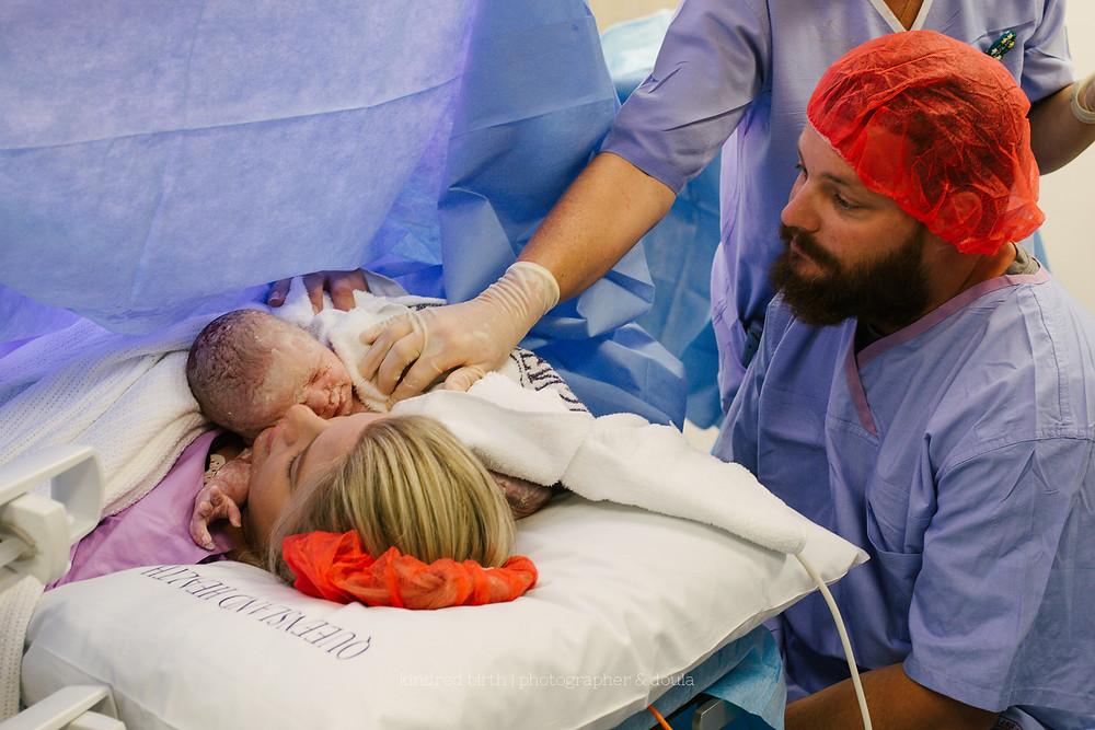 C-section birth newborn by Kindred Birth