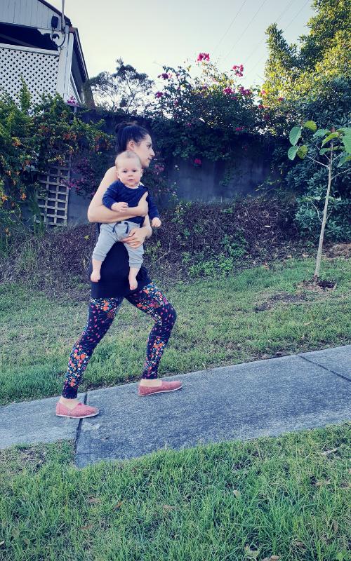 Sami walking with baby