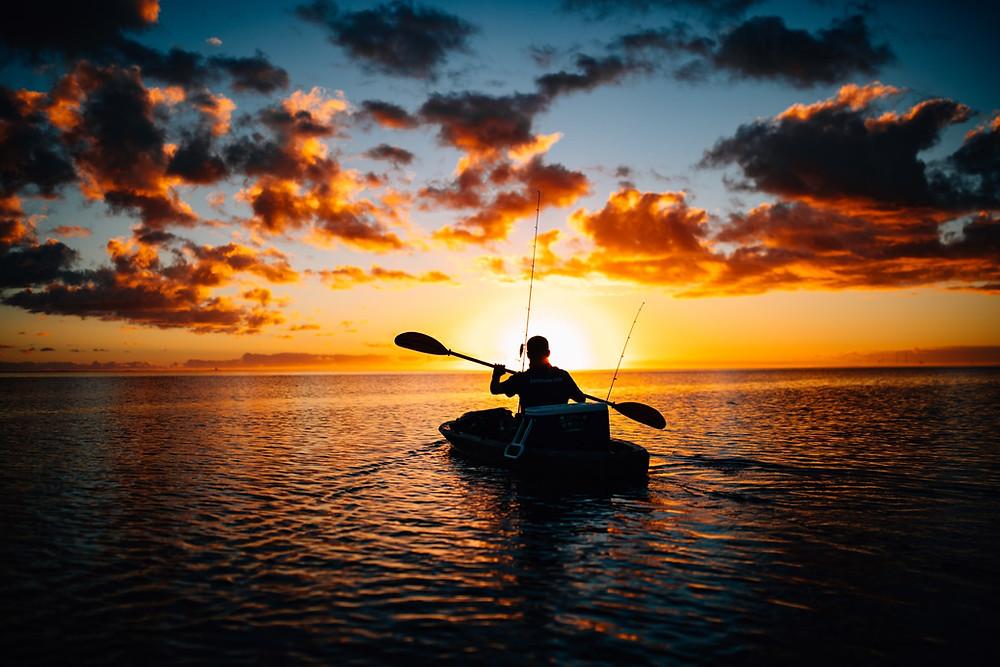 Kayak fishing at sunset