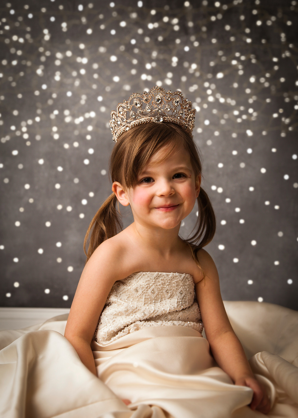 playing dress up in Mommy's wedding dress with a beautiful tiara