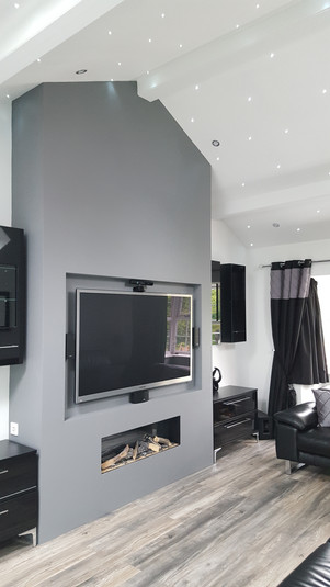 Custom made feature fireplace with inset TV & Living flame fire