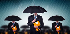 photo_businessmen-holding-umbrellas.jpg