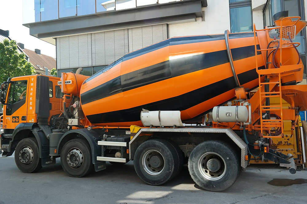 Orange and black cement truck