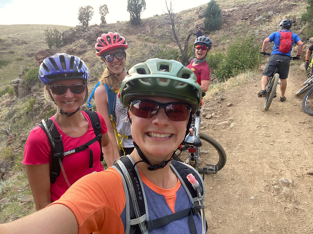 girls ladies women womxn having fun on mountain biking trail