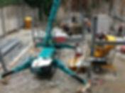 construction bureaux en cour intérieur avec mini grue