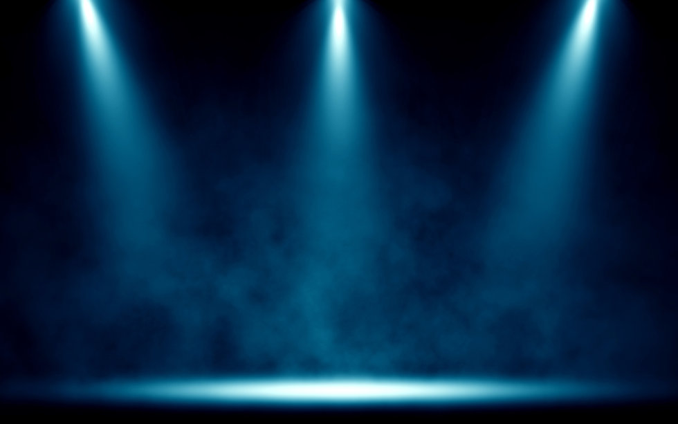 AdobeStock_238345414_three downlights on stage.jpeg