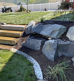 Landscape install of Sod, stairs, and boulders
