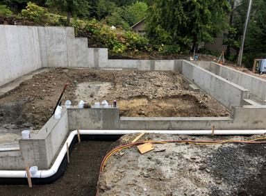 Downspout drainage around building pad.j