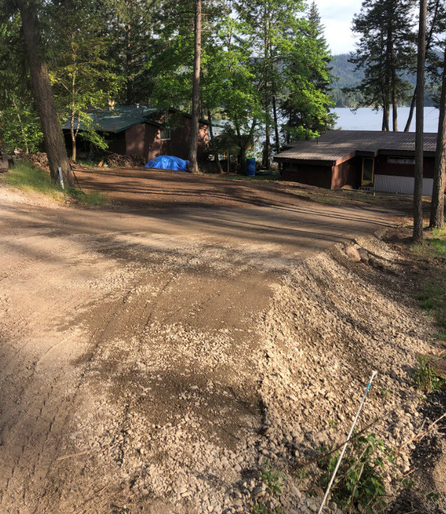 Finished driveway entrance and building