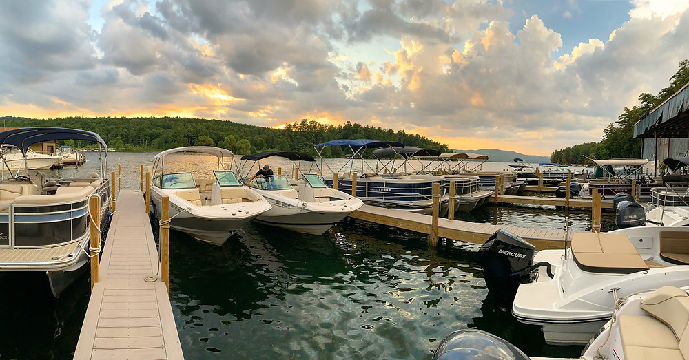 Our fleet of Freedom Boat Club boats tied up for the night with the sun setting behind them