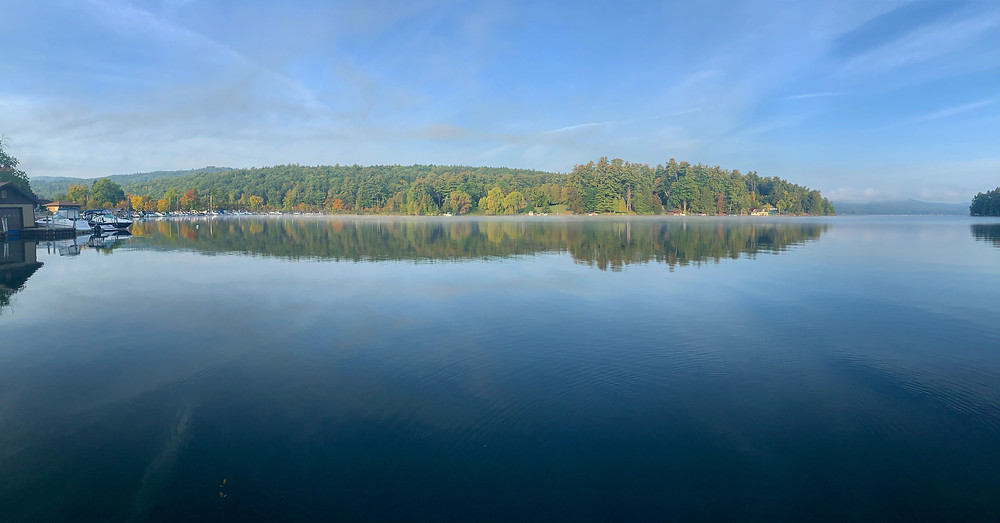 A calm mornint in Dunhams Bay with fall reflections on the glassy water