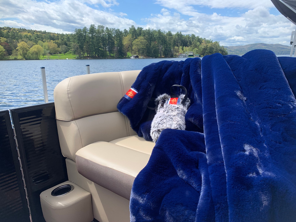 The Pretty Rugged blanket displayed on our pontoon boat. Great for keeping warm on Lake George!