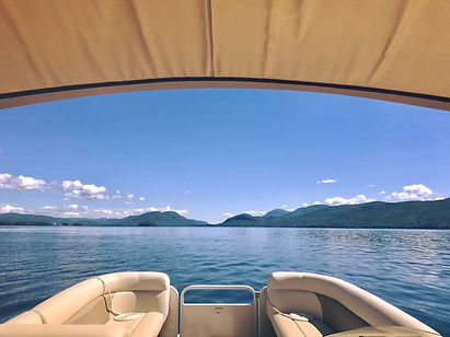 Freedom Boat Club member looking north at Dome Island and mountains aboard one of our Sweetwater tritoons