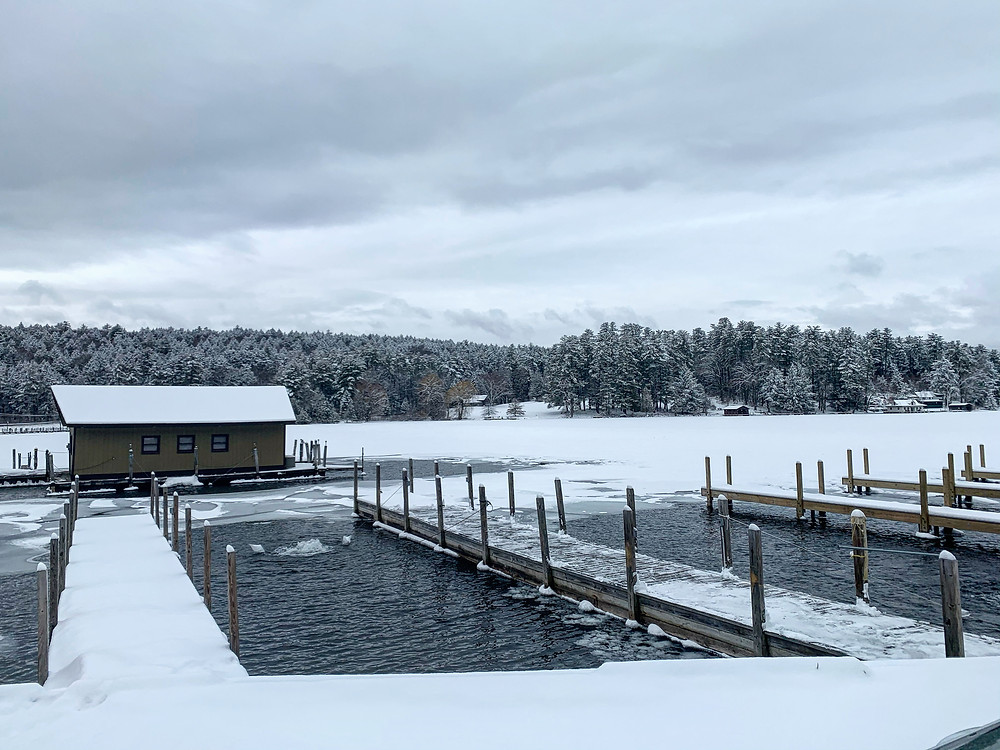 Docks and boathouse covered in fresh snow