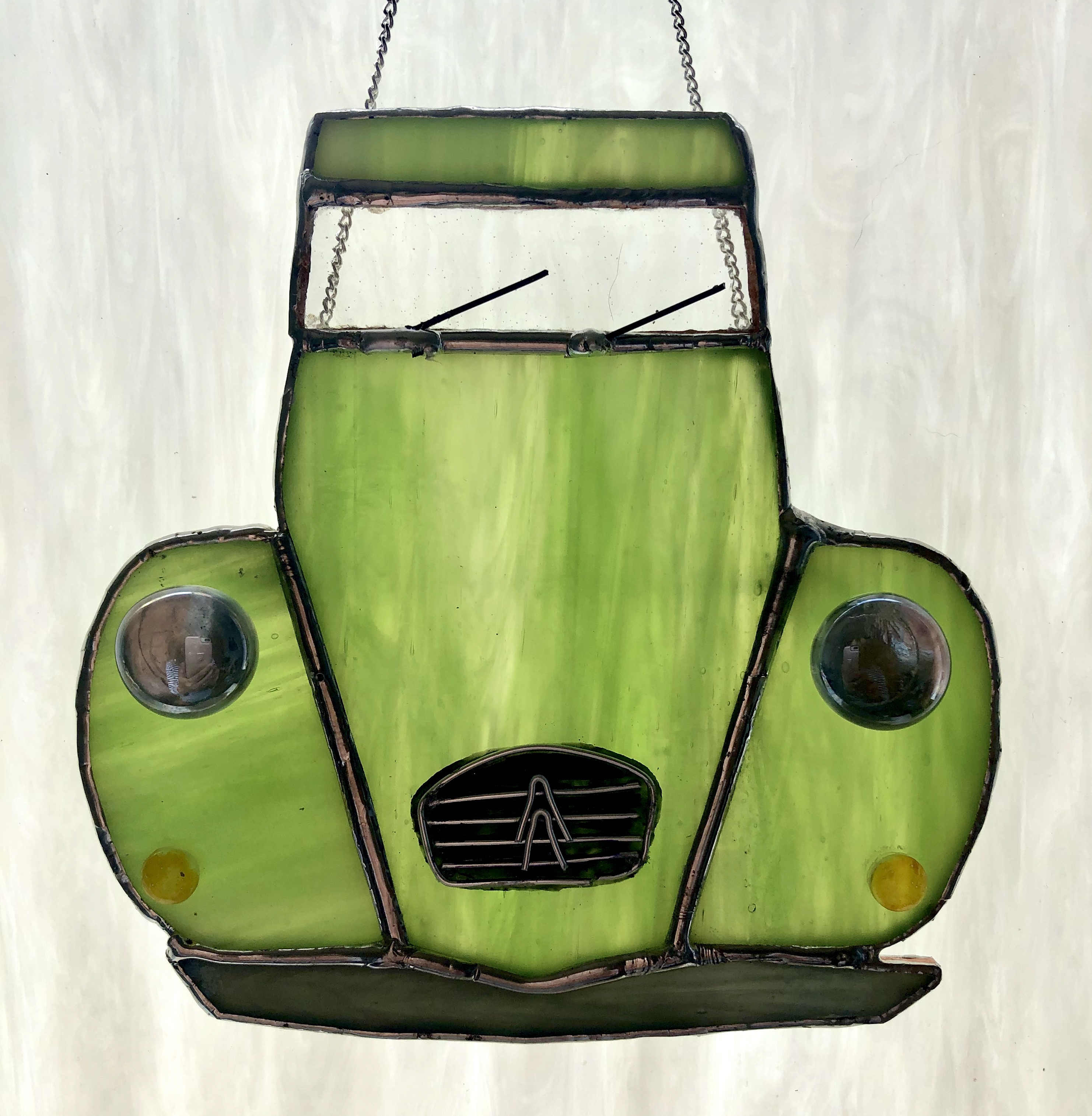 Beautiful 'streaky' green stained glass 2CV