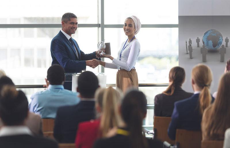 businesswoman-receiving-award-from-busin