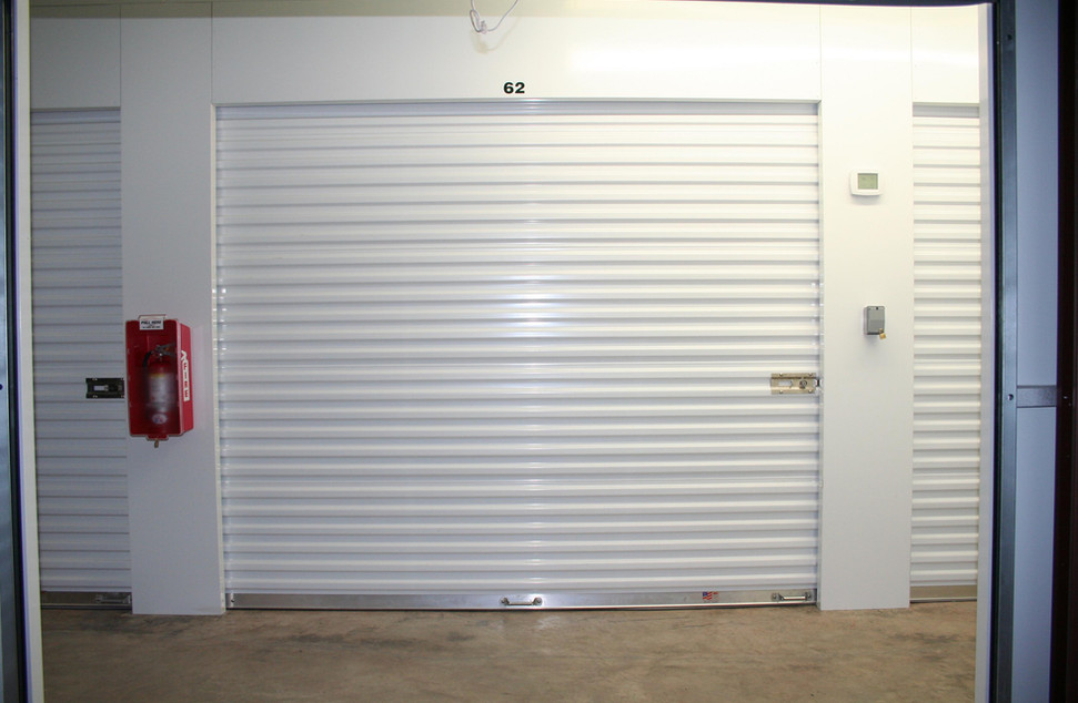 Flush piers - headers at roll-up doors.j
