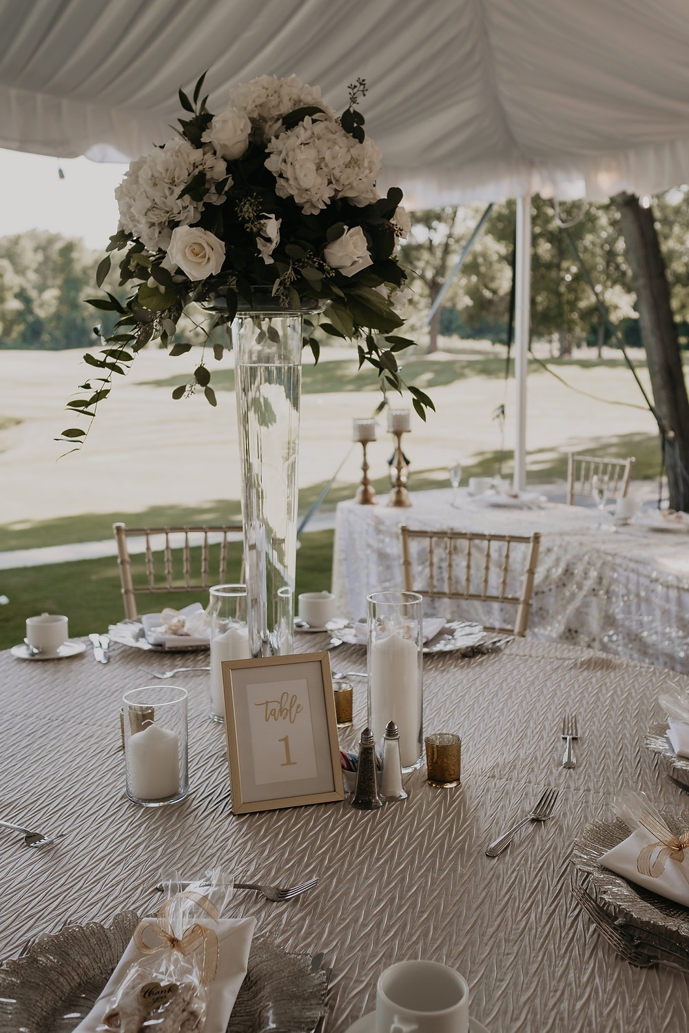 Floral centerpieces at summer metro Detroit wedding. Photographed by Nicole Leanne Photography.