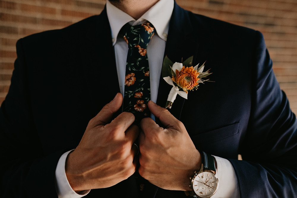 Groom in suit and tie ready for wedding. Photographed by Nicole Leanne Photography.