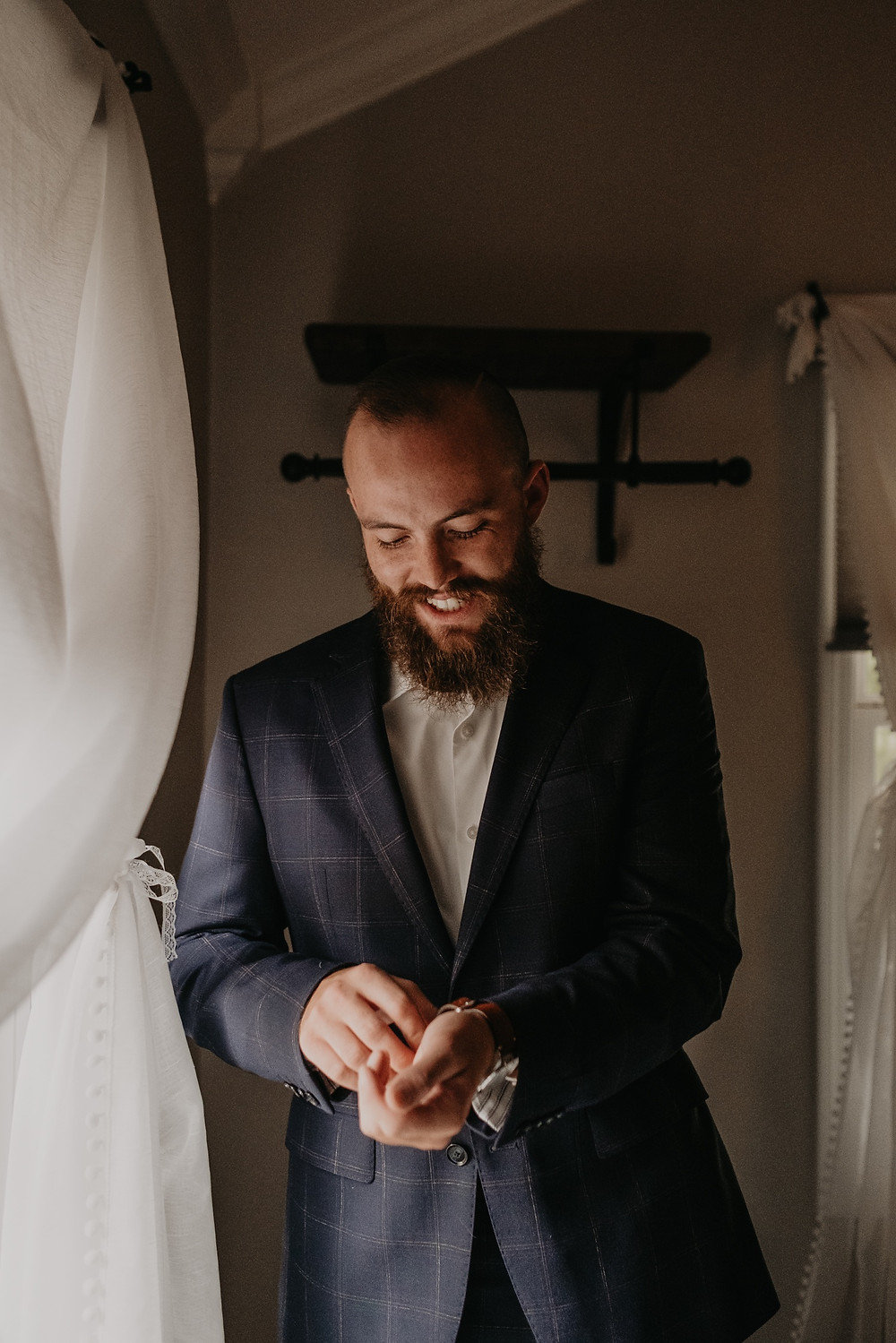Groom adjusting cuff links before wedding ceremony. Photographed by Nicole Leanne Photography.