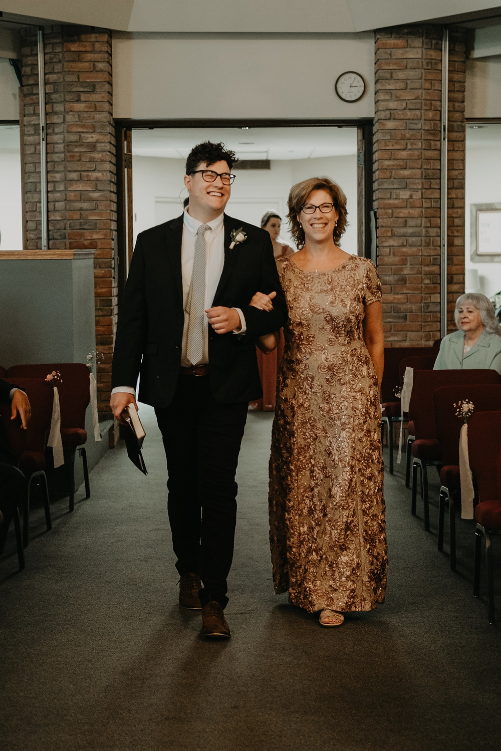 Wedding processional at church wedding. Photographed by Nicole Leanne Photography.